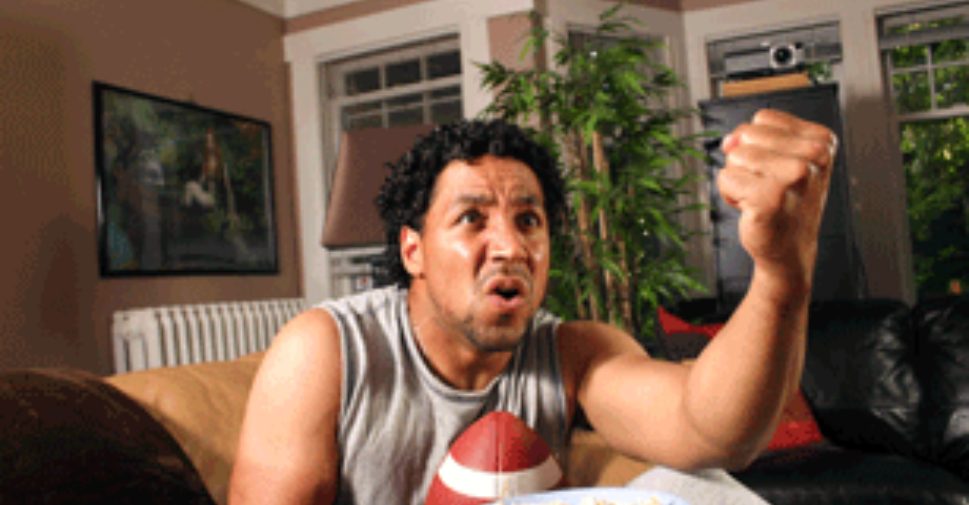 Man wathcing football