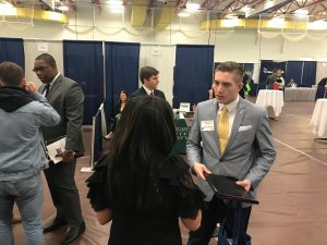 Northwood Unversity student speaking with Kelly LaFontaine at Job Fair