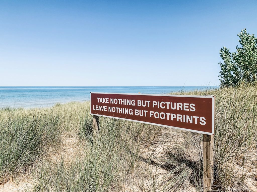 lake michigan onekama michigan, sign with quote take nothing but pictures leave nothing but footprints